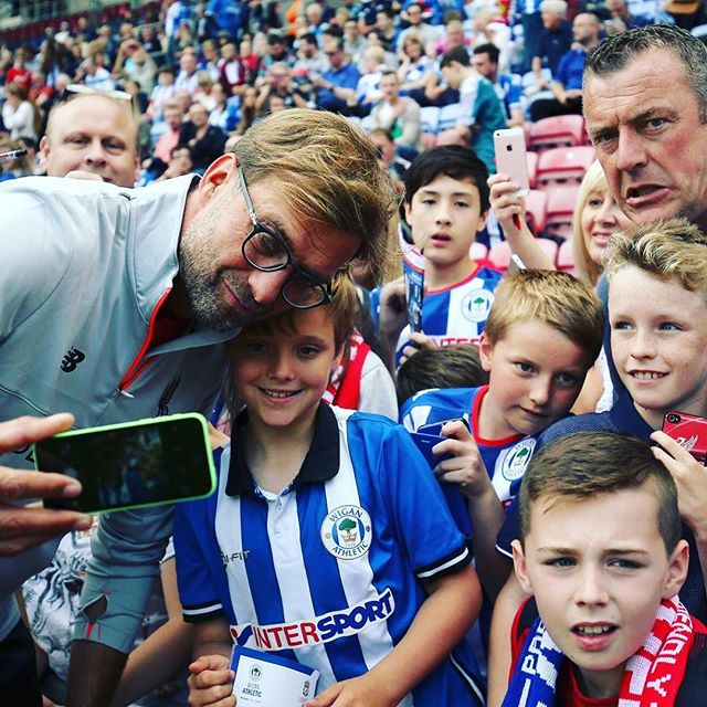Klopp takes a Selfie with the Wigan Fans