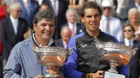 Spain's Rafael Nadal, right, poses with the special Decima cup while his oncle Toni Nadal holds the men's winner cup after the final match of the French Open tennis tournament at the Roland Garros stadium, Sunday, June 11, 2017 in Paris. Nadal has won his record 10th French Open title, beating No. 3 Stan Wawrinka in straight sets (AP Photo/Michel Euler)