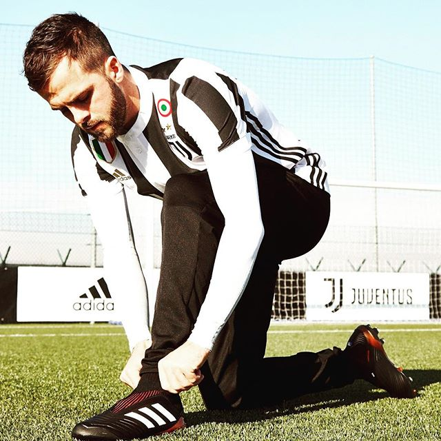 Calm before the Storm. Pjanic tries on the new Adidas Predator before the Big Clash with Barcelona tonight