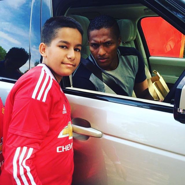 Antonio Valencia meets Aadam from the UK at the Man Utd Training Ground